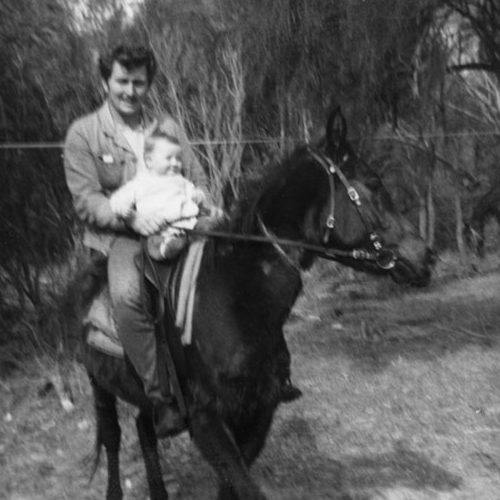 "alt=""Old black and white photograph of baby and father on a horse"""
