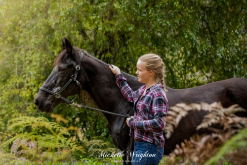 Girl rider and black horse outdoor photography